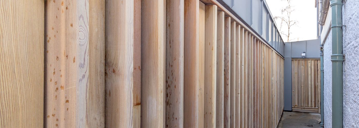 The larch cladding can be opened fully to access the storage wall